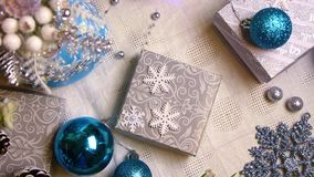 New year and christmas decorations and gifts in blue and silver color top view. 0:10 sec stock footage