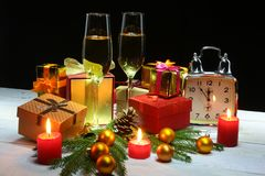 New Year or Christmas decorations with glasses wine, gift boxes, candles and balls. greeting card. Selective focus, copy stock image