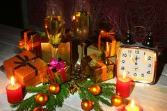 New Year or Christmas decorations with glasses wine, gift boxes, candles and balls. greeting card. Selective focus, copy stock images