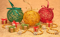 New Year 2015 decoration Christmas, handmade with golden bead. Snowflakes and gift boxes Stock Image