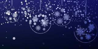 New Year Christmas decorations hanging on a blue background. Stock Image