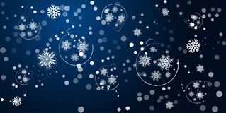 New Year Christmas decorations hanging on a blue background. Stock Photo