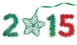 New Year 2015 decoration. Colorful snowflakes and green star. New Year 2015 decoration. Closeup colorful snowflakes and handmade green star Royalty Free Stock Photo
