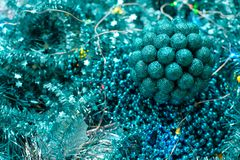 New Year or Christmas decorations of turquoise color: tinsel, balls, garlands royalty free stock image