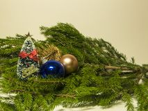 New Year and Christmas pictures. New Year and Christmas decorations on a white background. Branches, balls, toys royalty free stock photography