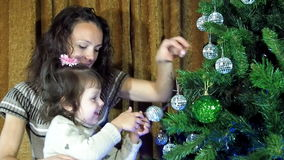 New Year, Christmas, family decorating a Christmas tree stock footage
