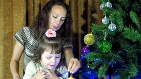 New Year, Christmas, family decorating a Christmas tree stock video