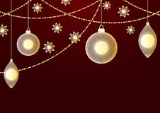 A New year or Christmas festive background with golden christmas balls, tassel, star light and a garland. A New year or Christmas festive background with golden Stock Images