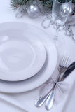 New year and christmas festive table set. On white table and decorated fur tree Stock Images