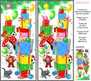 New Year or Christmas find the differences picture puzzle. New Year or Christmas visual puzzle: Find the ten differences between the two pictures of holiday Stock Photo