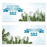 New Year Christmas. Flyer, business cards, postcards. invitations to the sale. Green tree branches in the snow. A ribbon. With an inscription. vector Stock Image
