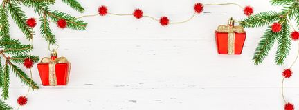 New Year or Christmas frame flat lay top view Xmas holiday celebration red decorative toys green fir tree branch white wooden. Background copy space Template stock photo