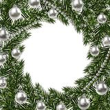 New Year Christmas. A green branch of spruce in a circle and snowflakes. silver balls and beads on a white background Royalty Free Stock Photos
