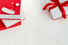 New Year or Christmas greeting card decorated white gift with red boxes with ribbons. Stock Photos