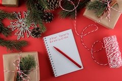 New Year. Christmas. Holidays. Composition with New Year and Christmas gifts and the New Year`s resolution form. stock photos
