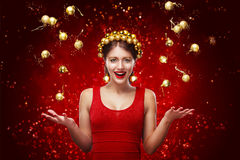 New Year, christmas, holidays concept - smiling woman in dress with gift box over lights background. 2017 Royalty Free Stock Photo