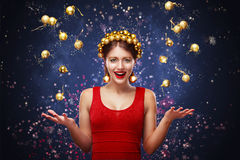 New Year, christmas, holidays concept - smiling woman in dress with gift box over lights background. 2017. New Year. Young happy woman with gift on bokeh royalty free stock photos