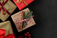 New Year. Christmas. Holidays. Frame of holiday gifts on a dark background. view from above. with space for text stock photography