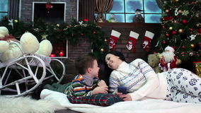 New Year. Christmas. Mom and son near Christmas stock video