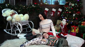 New Year. Christmas. Mom and son near Christmas stock footage