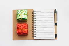 New year and christmas notebook with present boxes. New year and Christmas notebook with two green and red present boxes Stock Image