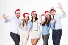 Group of young people in santa hat having fun on a white background. New Year or Christmas party. Group of young people in santa hat having fun on a white Royalty Free Stock Image