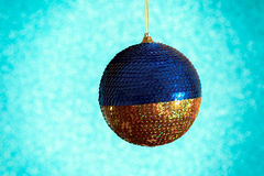 New Year. Christmas. Round Christmas toy yellow and blue on a br Stock Photo