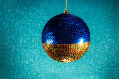 New Year. Christmas. Round Christmas toy yellow and blue on a br Stock Images