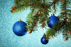 New Year. Christmas. Round Three blue Christmas toy hanging on t stock images