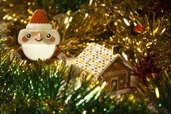 New Year and Christmas Santa Claus and gingerbread house in celebratory tinsel royalty free stock photos