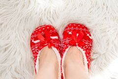 New year, Christmas slippers on white soft fur. Funny, funny, cozy.  Royalty Free Stock Photo