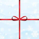 New Year and Christmas snow background. With red ribbon Stock Image