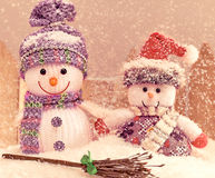 New Year 2015. Christmas. Snowmen, friendship. Retro on snow Royalty Free Stock Photography