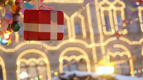 New Year and Christmas street scenery of the European city. The decorative gift box tied with a satin white ribbon stock video footage