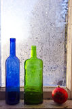 New year christmas toy and two old bottle on winter window with frost Royalty Free Stock Photography
