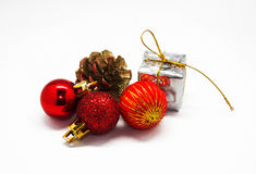 New year. The Christmas tree decorations, the cone, a gift isola Royalty Free Stock Images