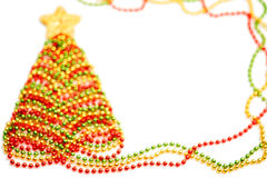New Year 2015 decoration. Decorative Christmas tree made of beads. With a star on white background Stock Photos