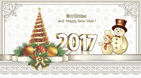 New Year 2017 with a Christmas tree and a snowman Stock Photo