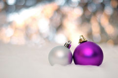 NEW YEAR, CHRISTMAS: Two Purple and Silver Balls. Merry Christmas Balls with Bokeh Background Stock Photos