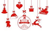 New Year Christmas. Various hanging ornaments, Santa hat, reindeer, heart, gift, dog and Christmas tree isolated on