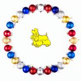New Year, Christmas Wreath of Colorful Balls with Yellow Dog. Top View. Royalty Free Stock Photos