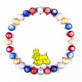 New Year, Christmas Wreath of Colorful Balls with Yellow Dog. Top View. Stock Photos