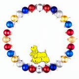 New Year, Christmas Wreath of Colorful Balls with Yellow Dog. Top View. Royalty Free Stock Images