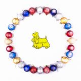 New Year, Christmas Wreath of Colorful Balls with Yellow Dog. Top View. Stock Photo