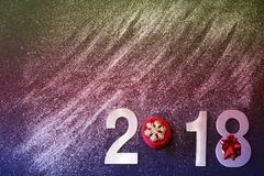 New Year 2018, the clayers are scattered, glisten and poured on a black background, copy space for your text, colorful toning.  stock photo
