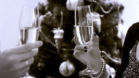 New Year Clinking Champagne Glasses witn Christmass tree old camera effect. 