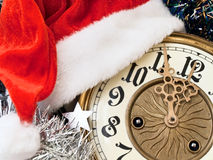 New year clock. With red hat and garland Stock Images