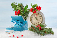 New Year clock with blue shoe Royalty Free Stock Photos