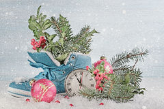 New Year clock with blue shoe and fir branches. Stock Image