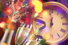 New year clock and blur light. Before midnight stock photography
